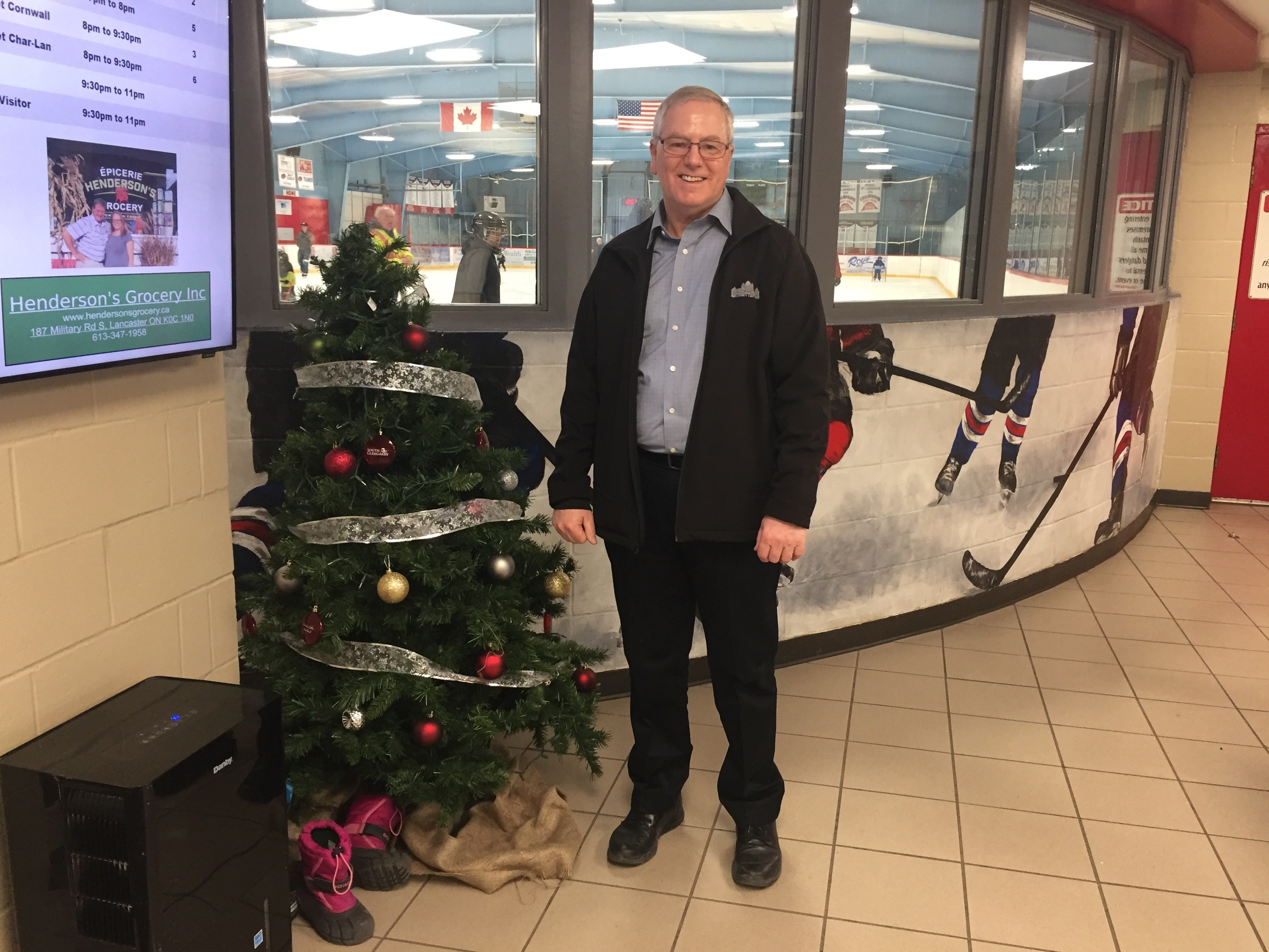 Picture depicting MPP Jim McDonnell next to a Christmas Tree in front of the skating rink at the Char-Lan Rec Centre for a Holiday Skate