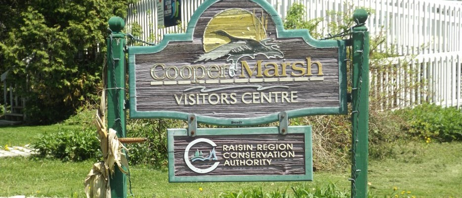sign that says Cooper Marsh Visitors Centre