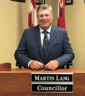 Councillor Martin Lang sitting at Council desk