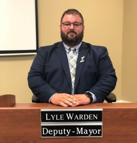 Deputy Mayor Lyle Warden sitting at Council desk
